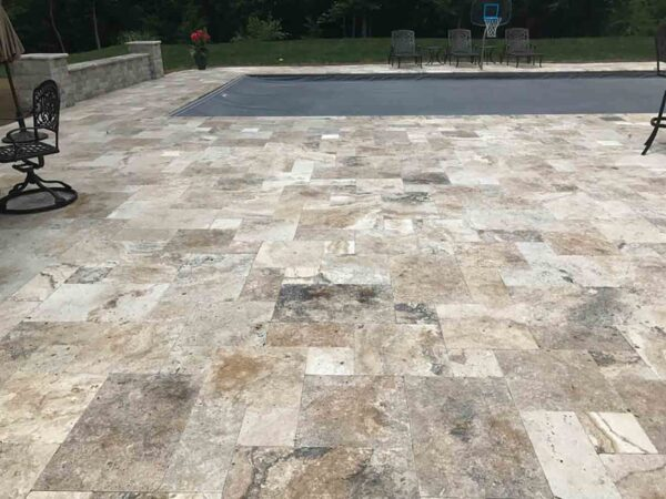 greige-travertine-patio-pool-deck-stone-patterned-natural-stones-supplier-greenstone-hardscape-supply
