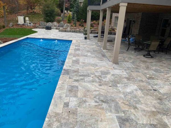 silver-travertine-patio-pool-deck-stone-patterned-natural-stone-supplier-greenstone-hardscape-supply
